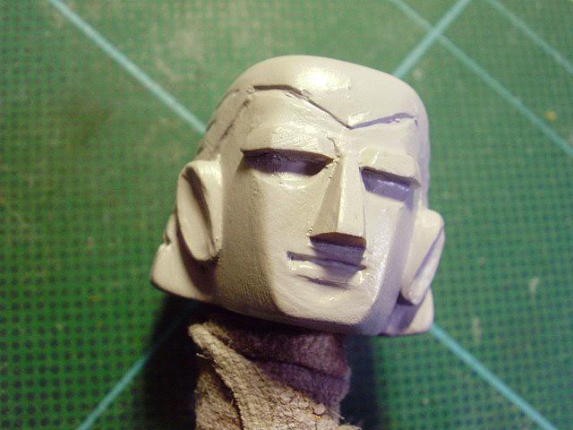 顔を彫ってます