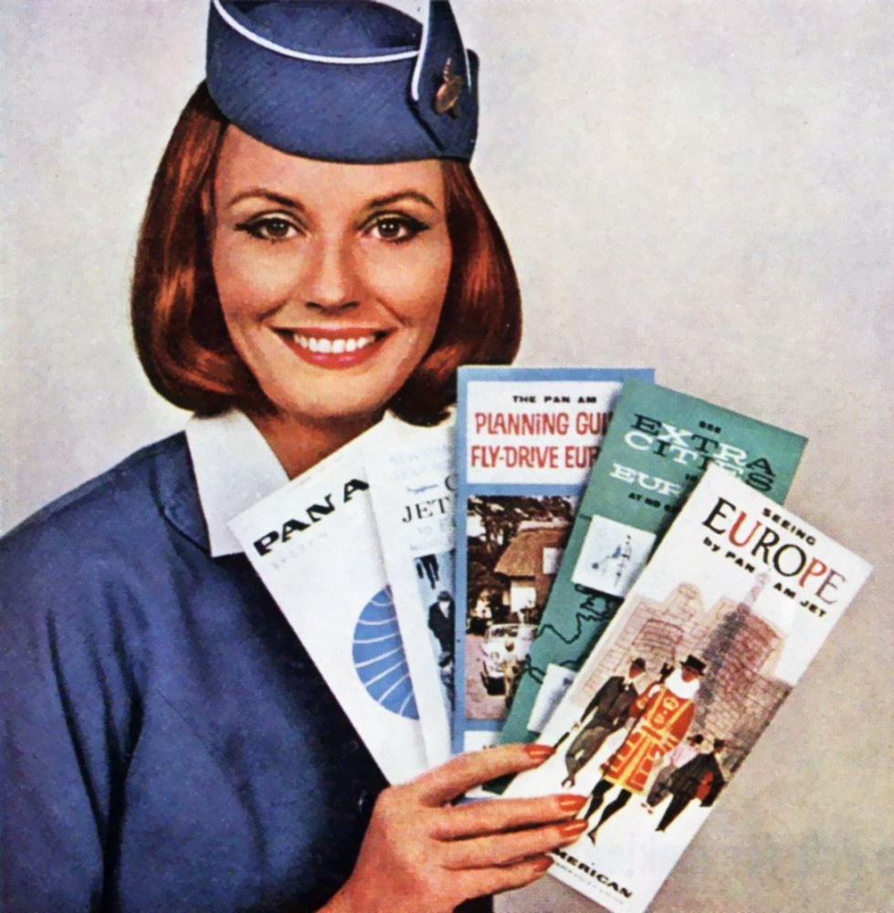 1963-Pan-Am-Flight-Attendant-with-brochures.jpg