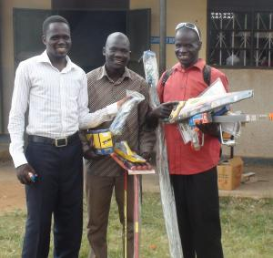 Odong Justine receiving his tools with his brother