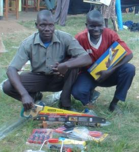 Ojara and Kenneth Pose for a photo with some tools
