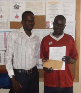 Ojara Benson receiving micro credit