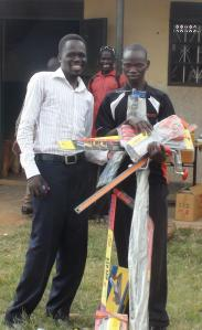 Olal Michael receiving his tools and equipment