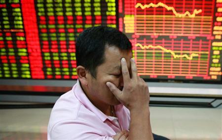 シナ株急落で頭を抱える投資家
